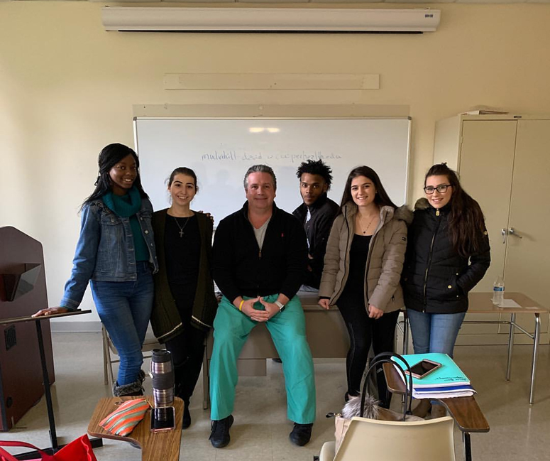 Picture of E-Board Members of Health Professional Club with Guest Speaker