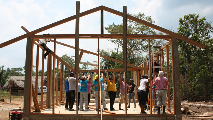 Caldwell University students and faculty members building a house