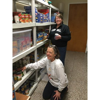 Staffs Sorting the items in Food Pantry
