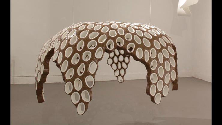 "Robert Lach, Wrapped, 2016, cardboard, tape, foam, 29"" x 52"" x 52"""