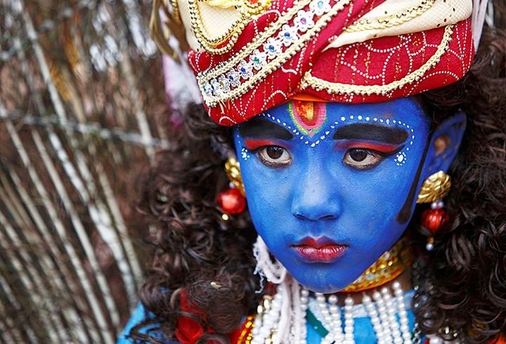 A boy dressed as Lord Krishana (A Hindu God)
