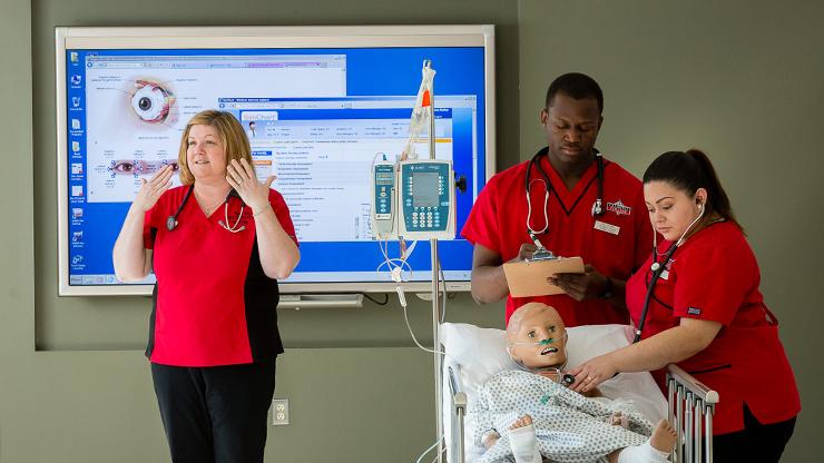 Nursing student demonstrating practical application of handling a patient