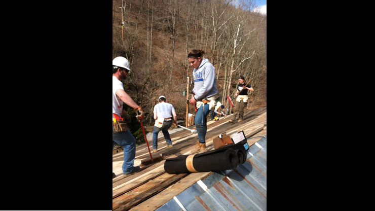 Caldwell Students repairing a house in Appalachia