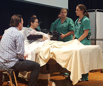 Students simulate real-life maternal death story.
