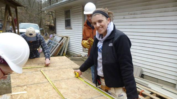 Students measuring a roof board