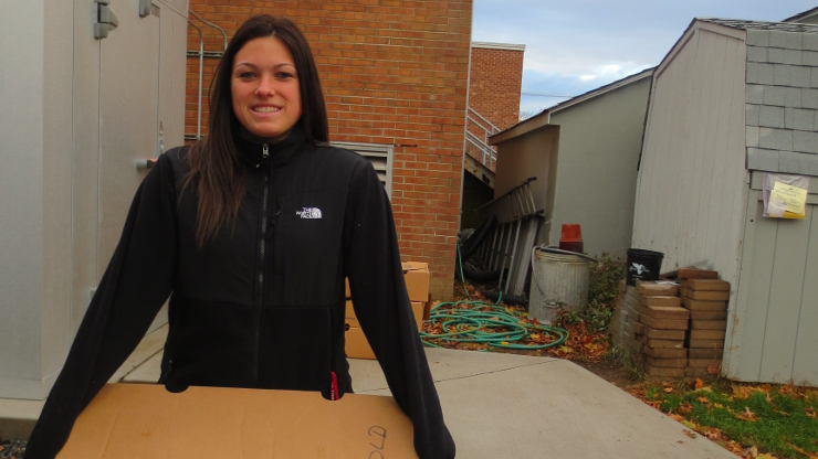 Briana-Gaspich carrying donation material.