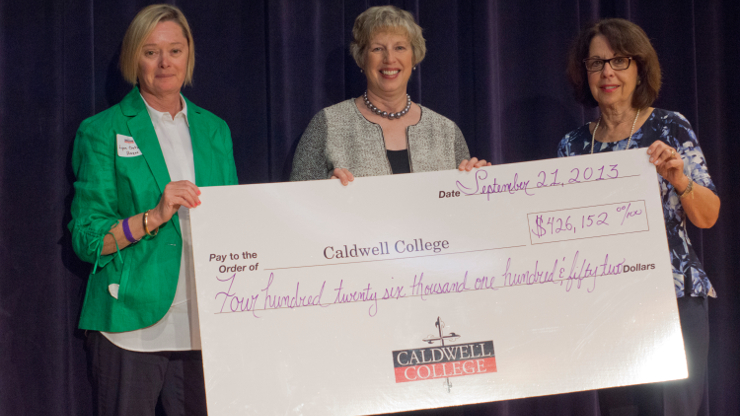 Donation cheque handed to Caldwell University President