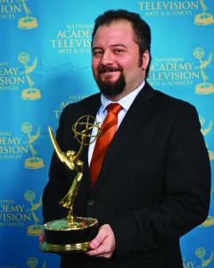 Justin Cece Holding Emmy Award