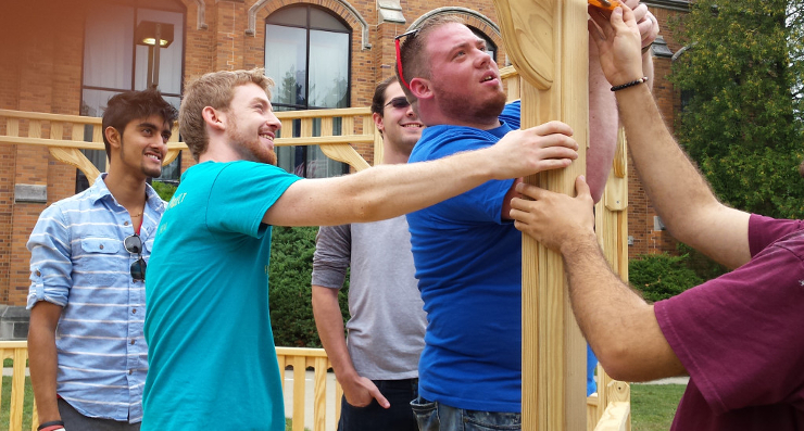 Students and Faculty Helping the Construction of Gazebo