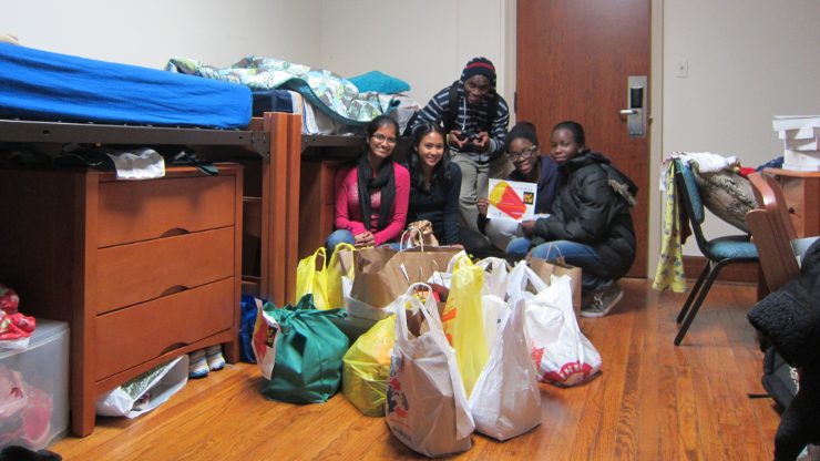 Students with donation material for Thanksgiving