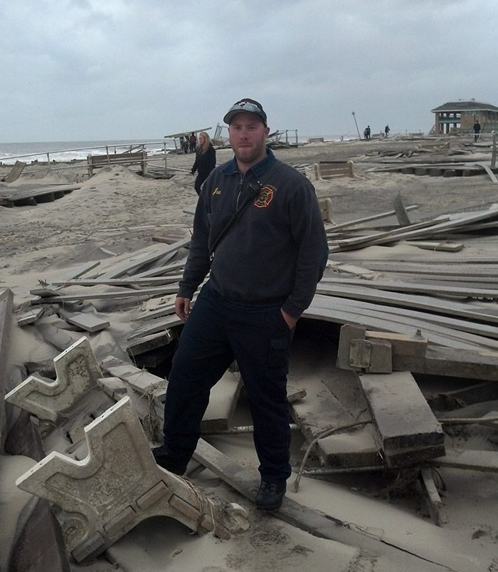 Caldwell student Joe Tompey, a Spring Lake Heights fire department lieutenant, stands in the wreckage of the Spring Lake boardwalk
