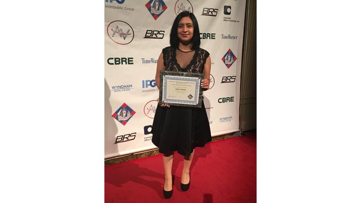 Karla Barzola Holding scholarship award by National Hispanic Business Group