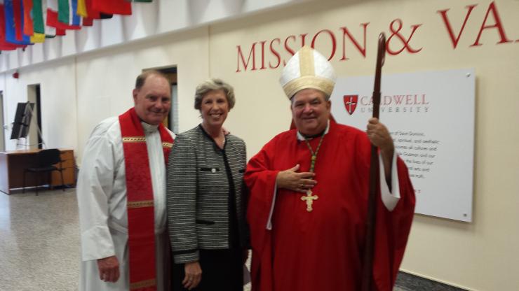 Archbishop Hebda, Dr. Nancy Blattner and Father Al Berner