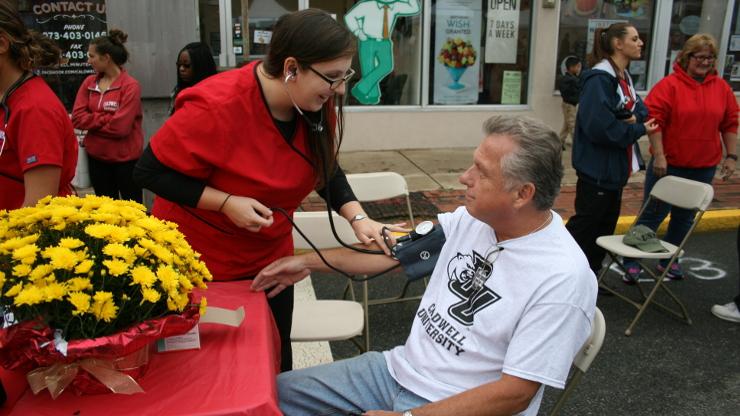 Caldwell University nursing students providing free blood pressures screenings