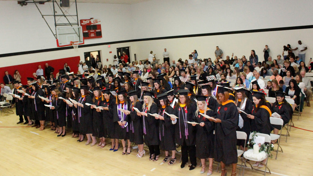 Caldwell University School of Nursing and Public Health graduating seniors taking an oath during annual convocation and professional pinning at May 18.