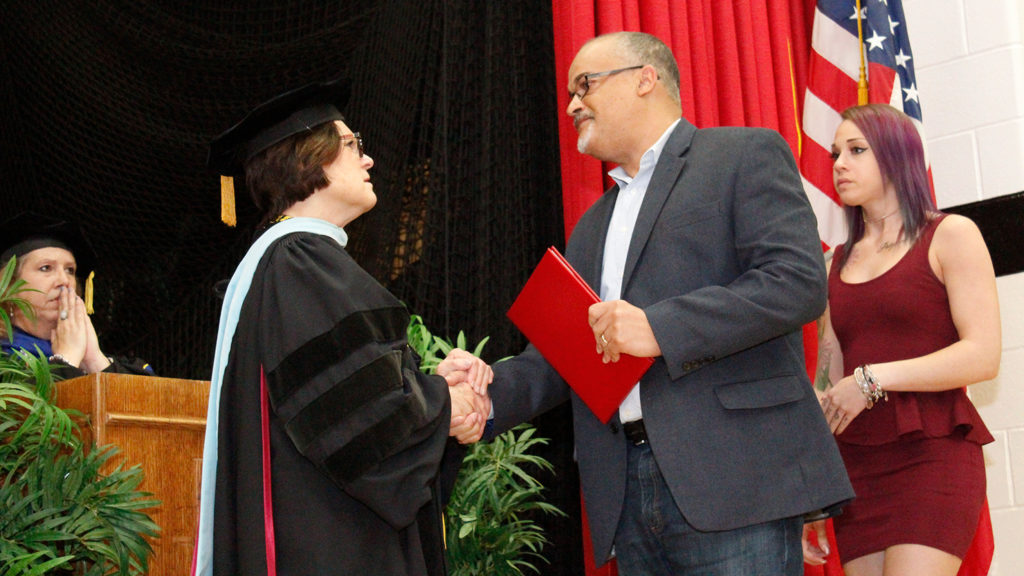 Caldwell University School of Nursing and Public Health graduating senior collecting certification during annual convocation and professional pinning at May 18.