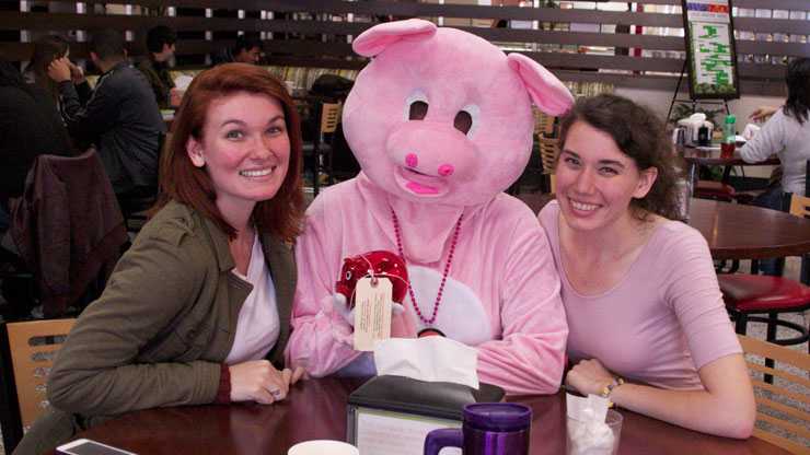 Phil the pig with students