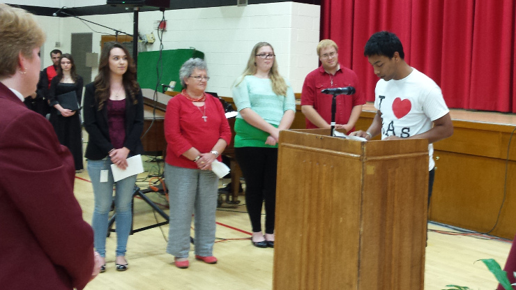 Prayers of the faithful , a Caldwell student delivering speech