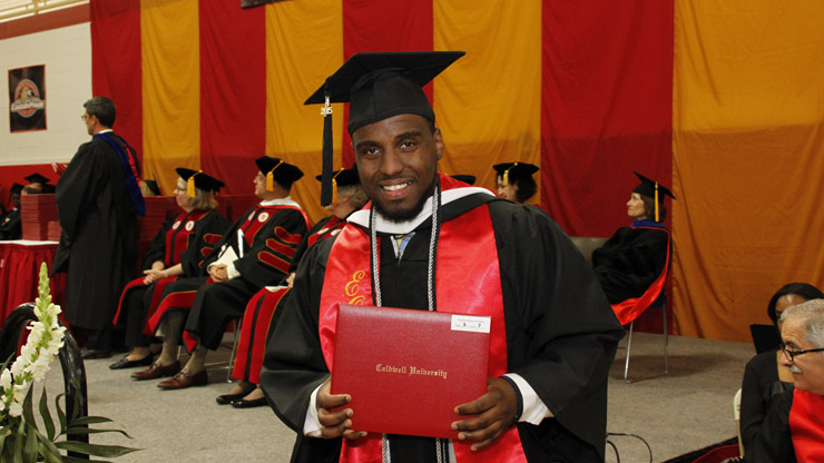 Stephon Davis holding his graduation certificate