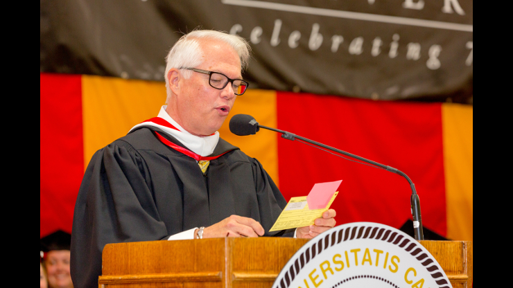Professor Bob Mann addressing the 75th annual commencement