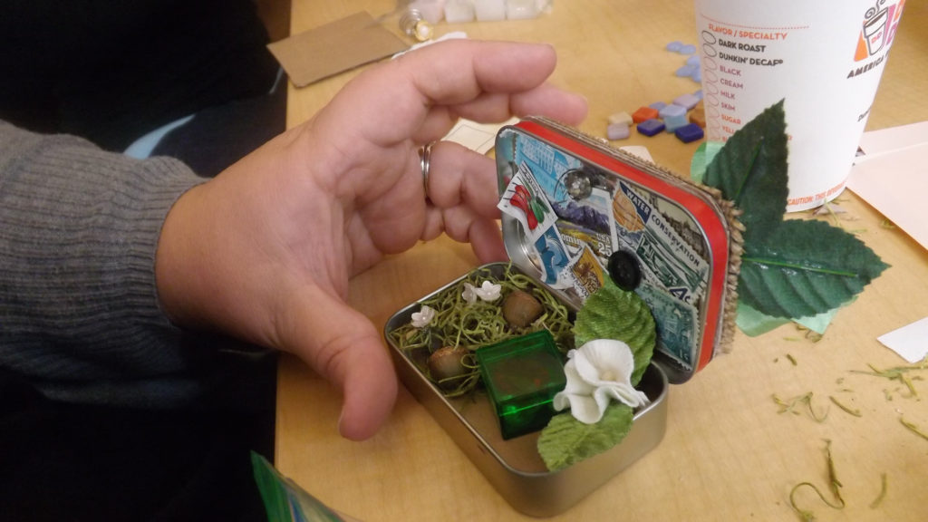 A creation piece representing a safe space using Altoid tins