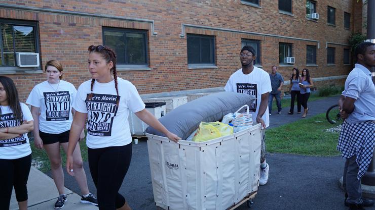 Freshmen moving in the dorm