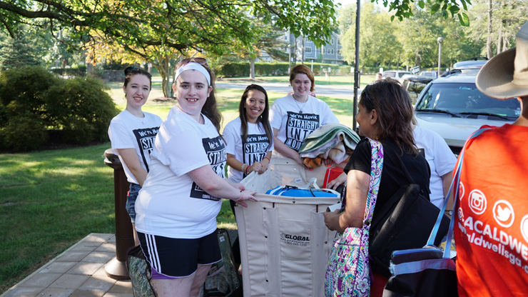 Group of Students helping Freshman on Moving Day