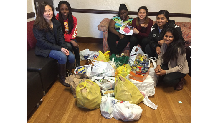 Caldwell University Health Professions Club members with collected food for Community Food Bank