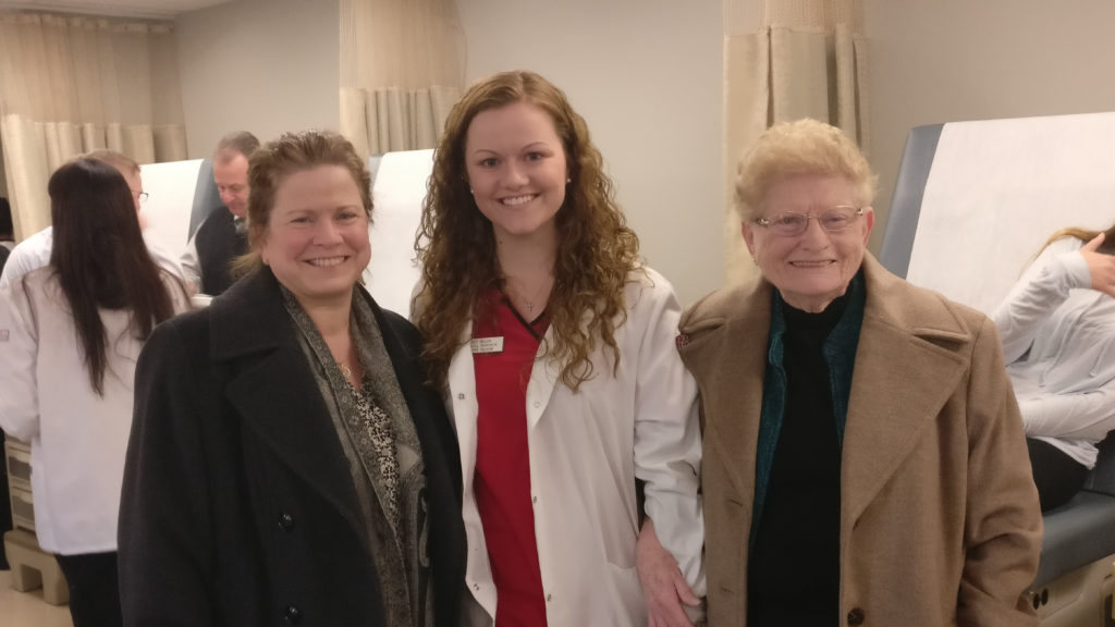 Nursing student Catherine Mulick with her mother and grandmother, a family of three generations of nurses.