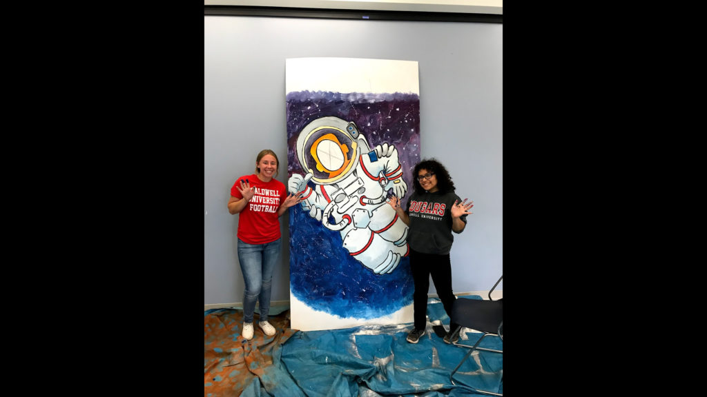 Two Caldwell Student painitng a potrait for ARC of Essex County Stepping Stones School