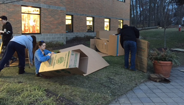 Caldwell University students cleaning up the boxes after sleeping whole night outside to support Campus Ministry project Boxtown aimed at raising awareness about homelessness.