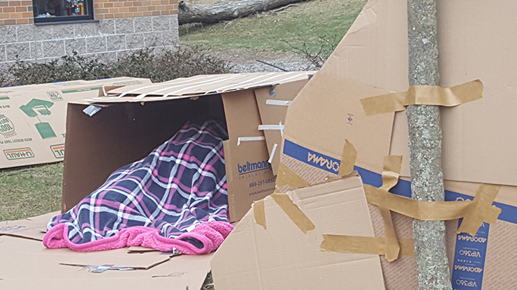 Caldwell University students sleeping whole night outside on a box to support Campus Ministry project Boxtown aimed at raising awareness about homelessness.