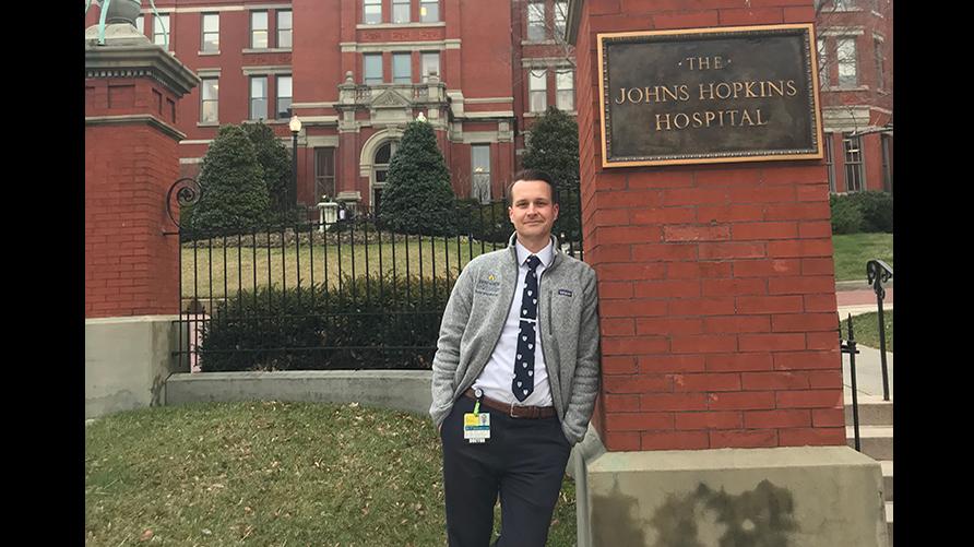 Bryan Broderick Caldwell University Graduate (2011) outside John Hopkins Hospital.
