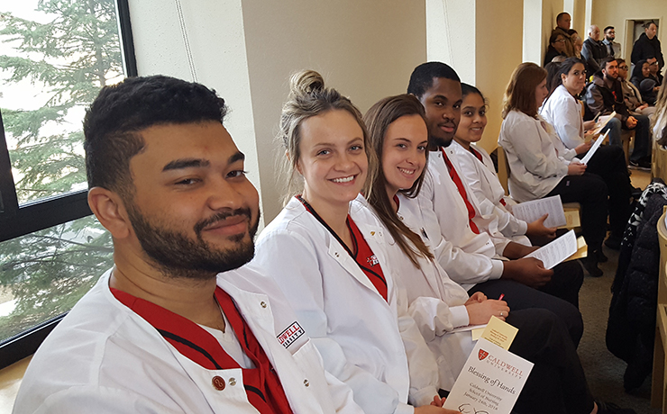 Caldwell University Nursing students participating in Nursing Blessing of Hands Ceremony.