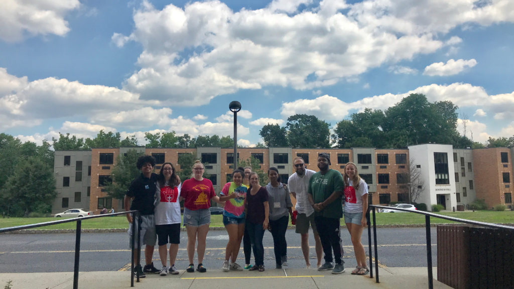 Caldwell University Students outside Rosary Hall taking a group photo.
