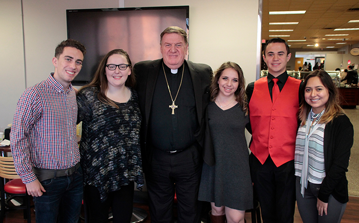 His Eminence Joseph William Cardinal Tobin, C.Ss.R., D.D., Archbishop of the Newark Archdiocese, taking a group picture with Caldwell University Students.