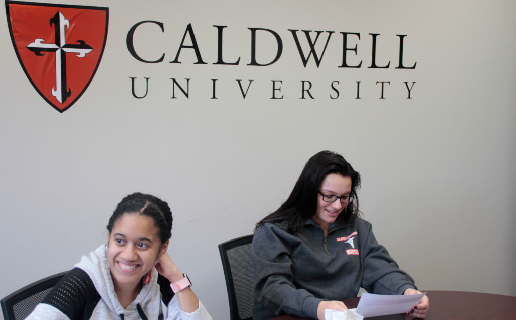 Caldwell University students contacting their federal representatives to urge them to support Dreamers.