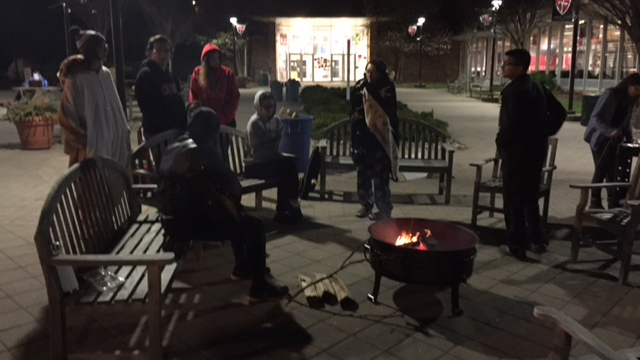 Caldwell University students having a bonfire, took part in a poverty simulation to support Campus Ministry project Boxtown aimed at raising awareness about homelessness.