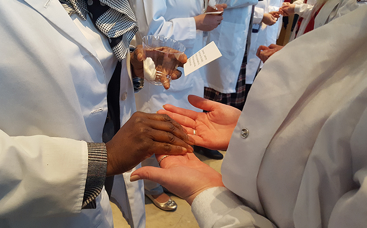 Caldwell University Nursing student participating in Nursing Blessing of Hands Ceremony.