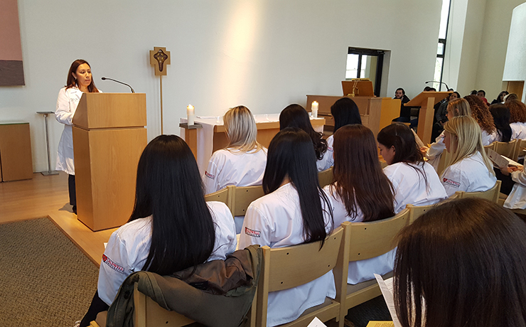Director of Campus Ministry Colleen O'Brien giving a speech to the Caldwell University junior nursing students.