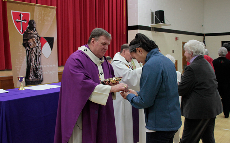 His Eminence Joseph William Cardinal Tobin, C.Ss.R., D.D., Archbishop of the Newark Archdiocese, blessing Caldwell University Students.