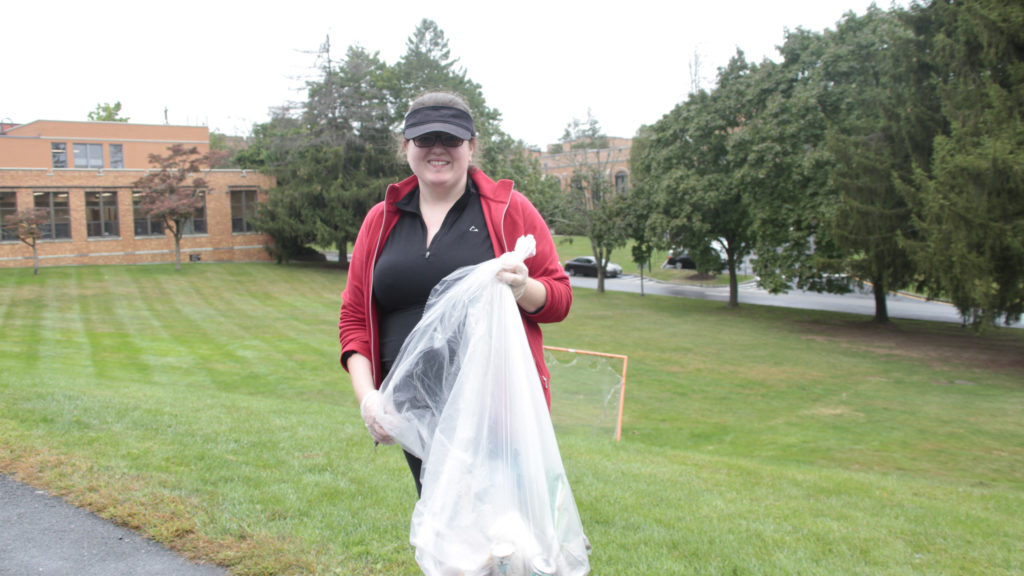 A Student Helping to Clean a Local Park