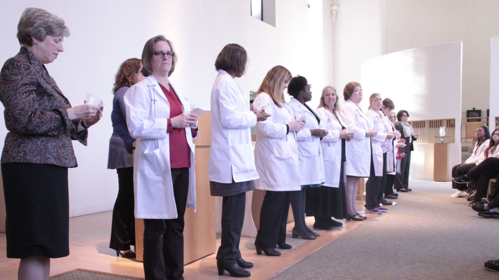 Caldwell Faulty and Staffs at annual Blessing of the Hands ceremony
