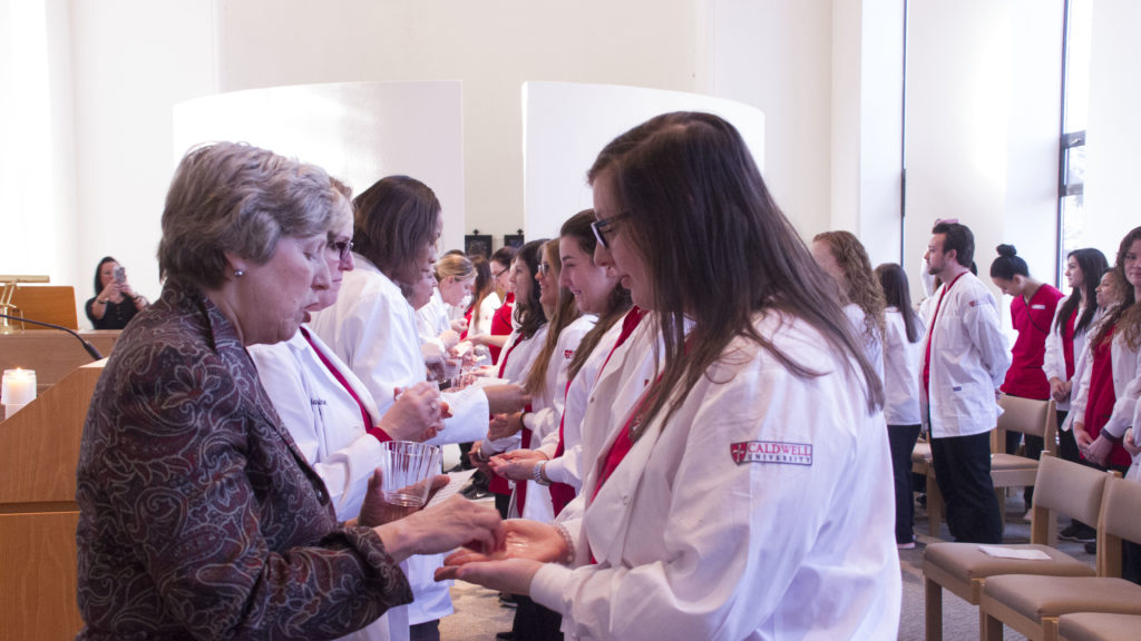 Nursing Students Receiving Blessings of Hands from Faulty and Staffs