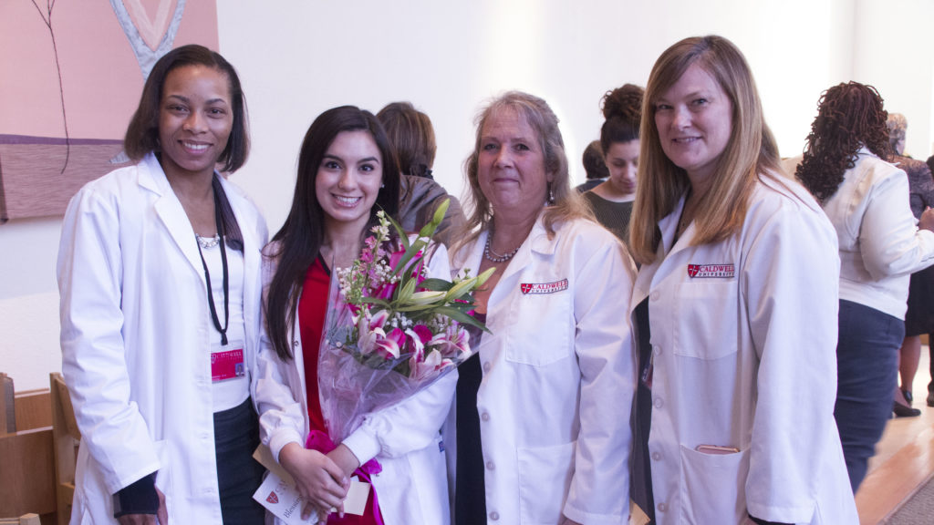 Nursing Student and Faculty after the Blessing of Hands Ceremony