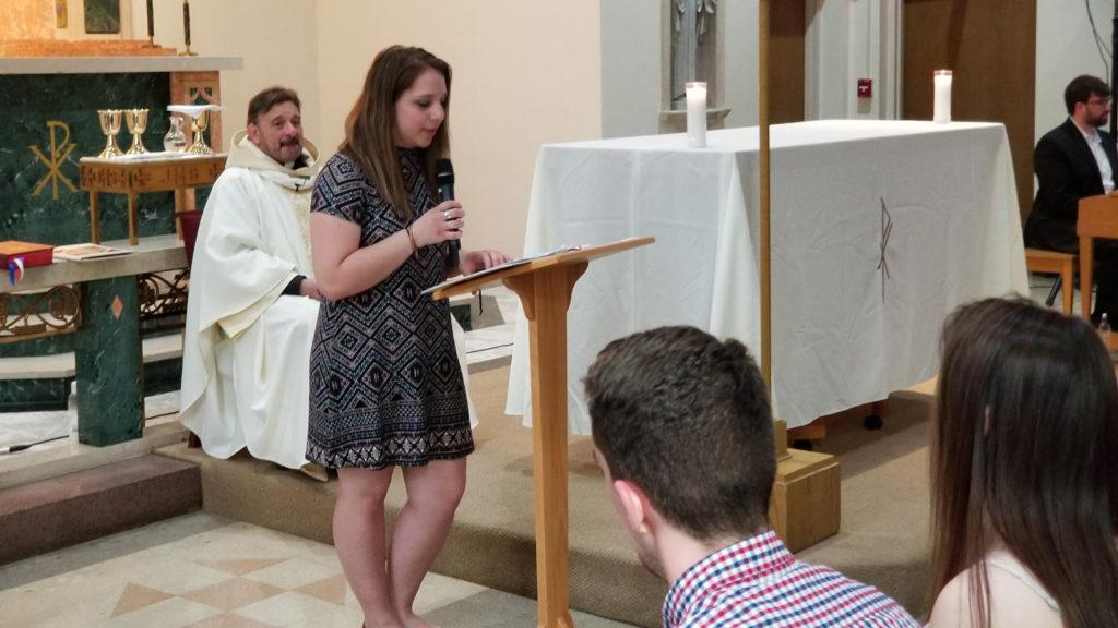 Member of Caldwell Community addressing the Mass Celebration