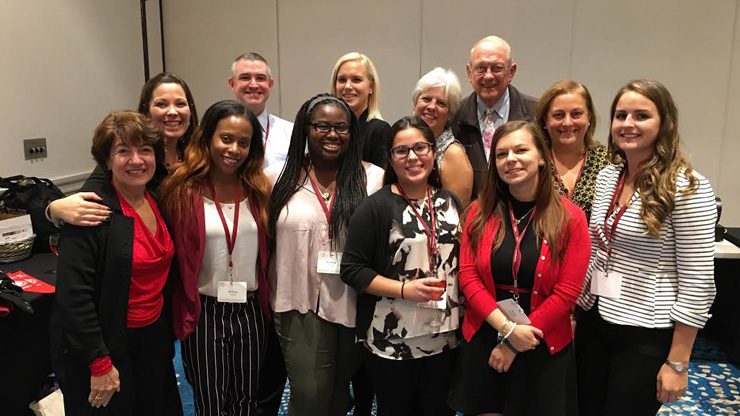 Caldwell School Counseling graduate students volunteered at the New Jersey School Counselor Association Conference. Front row (left to right); Conference presenter Dr. Carol Dahir, Students Jennice Young, Ronieka Thomas, Melissa Villafane, and Anna Gurevich. Back row (left to right): New Jersey School Counselor Association President elect-elect Dana Kurilew, President of NJSCA Timothy Conway, Student Ashley Pritchard, Conference presenter Dr. Trish Hatch, Executive Director of NJSCA Jim Lukach, NJSCA President-elect Dana Karas, and Student Rachel Shapiro.
