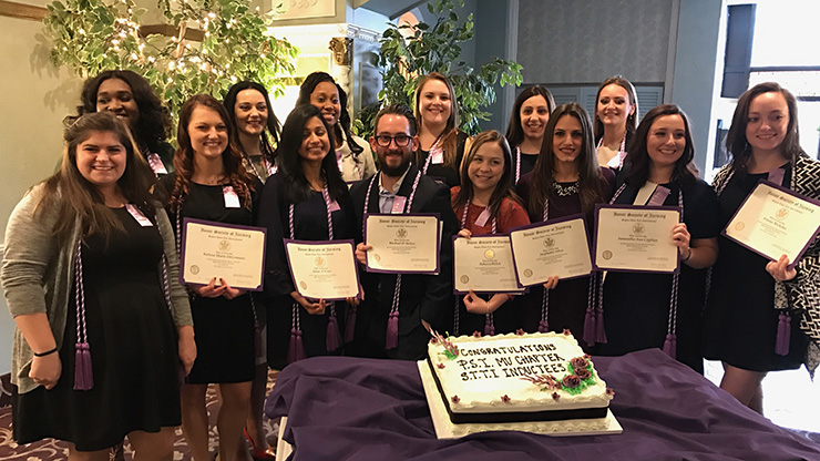 Caldwell University Department of Nursing Students displaying an official charter membership of the international honor society of nursing, Sigma Theta Tau, at a ceremony on March 11 at the Bethwood in Totowa, New Jersey.