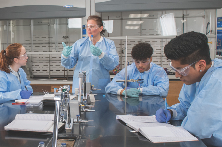 An image of Agnes Berki in the lab with Caldwell students