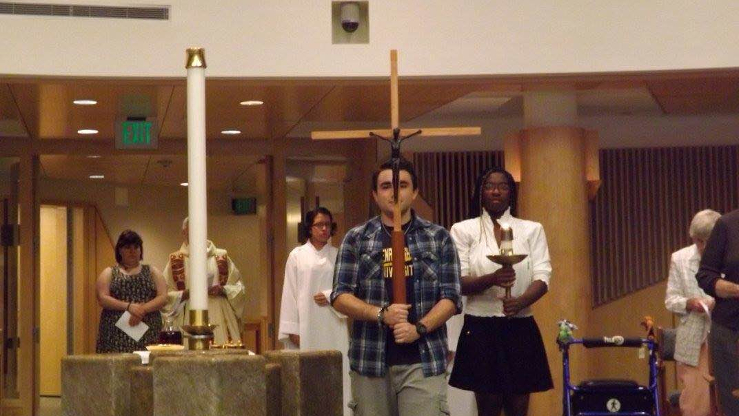 Students Holding the Cross to Mark Initiation of the Ceremony